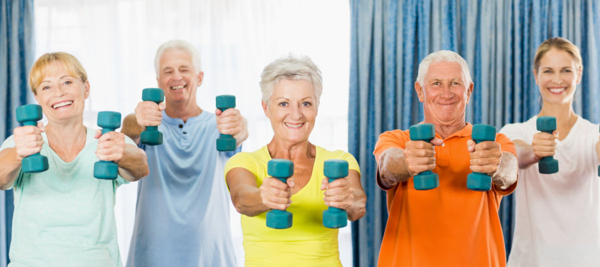Older people holding weights
