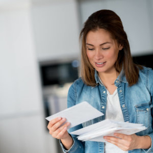 A woman is reading her mail